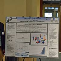 Darrien Hayman with his reseach poster